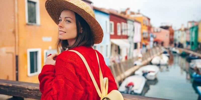 Attractive woman in a straw hat in Burano